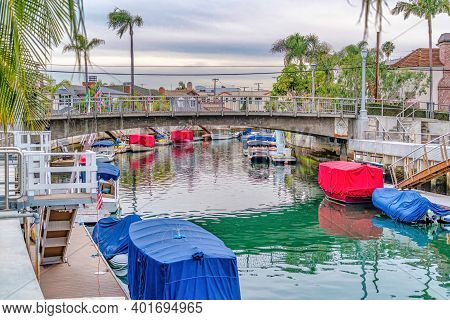 Footbridge Over Canal With Stairs Going To Boat Docks In Long Beach California