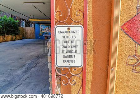 No Parking Warning Sign For Unauthorized Vehicles In Huntington Beach California