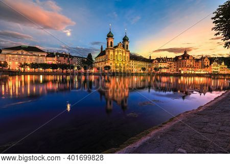 Amazing Sunset With Colorful Clouds In City Downtown Of Lucerne In Central Switzerland. Jesuitenkirc