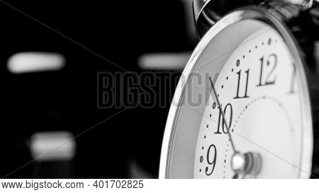 Black White Big Metallic Clock Close Up. Time Or Showing Time Concept. Classic Retro Mechanical Alar