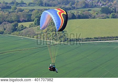 Tandem Paraglider Flying Wing At Combe Gibbet, England