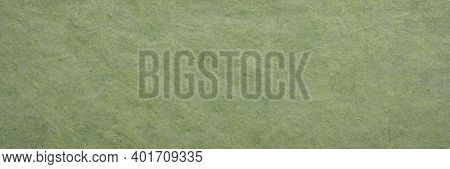 background and texture of a green paper made in Bhutan by tsharsho papermaking methods, panoramic banner