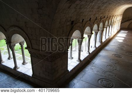 Girona Cathedral, Spain. Historic Cloisters. High Angle Shot With Dramatic Light And Shade As Sunshi