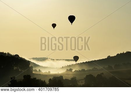 Hot Air Balloons Floating In The Morning Light