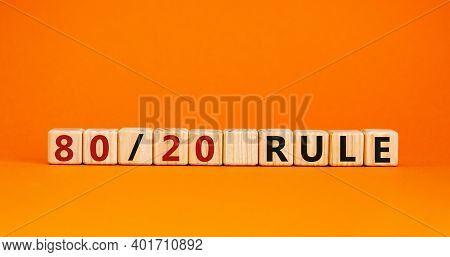 80 On 20 Rule Symbol. Wooden Cubes With Words '80 On 20 Rule'. Beautiful Orange Background, Copy Spa
