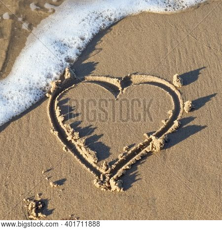 A Beautiful Heart Shape Painted Into The Sand Of A Baltic Sea Beach With Some Water Waves