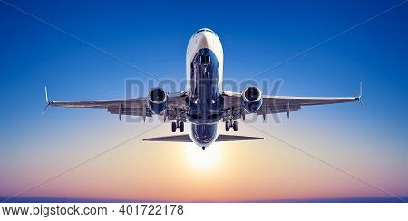 Modern Airliner Takes Off Against A Sunset