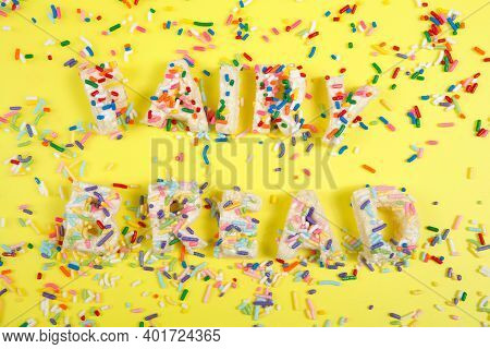 Fairy Bread Spelled With Fairy Bread On A Bright Yellow Background With Candy Sprinkles Spilled Abou