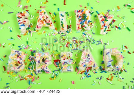 Fairy Bread Spelled With Fairy Bread On A Bright Green Background With Candy Sprinkles Spilled About