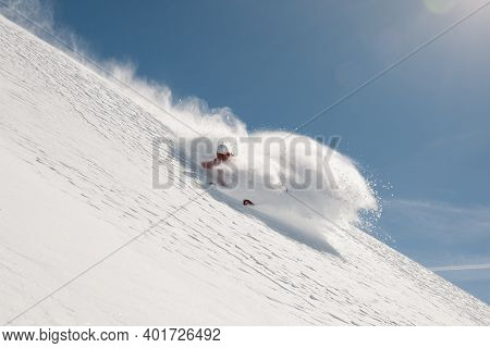 Stock Picture Of A Freeride Skier That Is Skiing Fast Downhill In Deep Powder Snow. There Is A Beaut