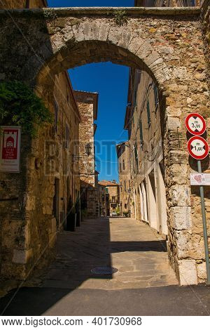 A Roman Gate, Porta Romana, In The Village Of Montemerano Near Manciano In Grosseto Province, Tuscan