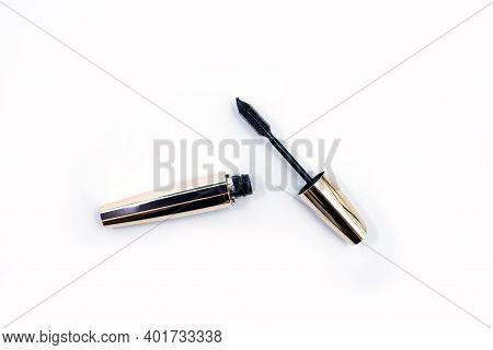 Mascara Black Bottle And Applicator Brush. Fashionable Cosmetics Makeup For Eyes, Black Mascara Wand
