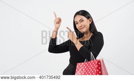 Sexy Woman Shopping. Portrait Of Beautiful Girl Holding Shopping Bags