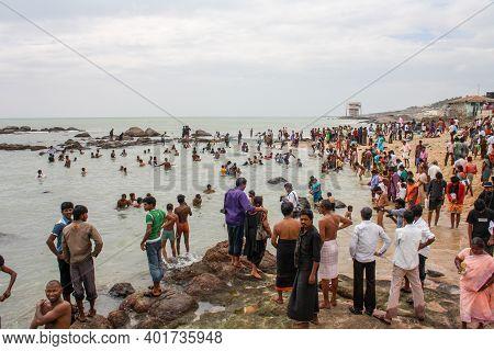Kanyakumari, India - January 16, 2011: Group Of People Bathing At The Local Beach