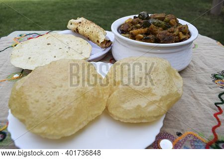 Indian Gujarati Lunch Or Dinner Of Puri And Undhiyu Or Undhiya Curry And Rolled Papad For Festival S