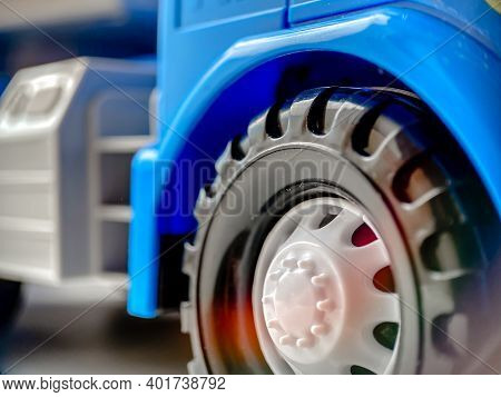 Close-up Of A Wheel From A Blue Children's Toy Car. Closeup Of Children's Toys And Goods.
