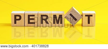 Permit Word Written On Wood Block. Permit Word Is Made Of Wooden Building Blocks Lying On The Yellow
