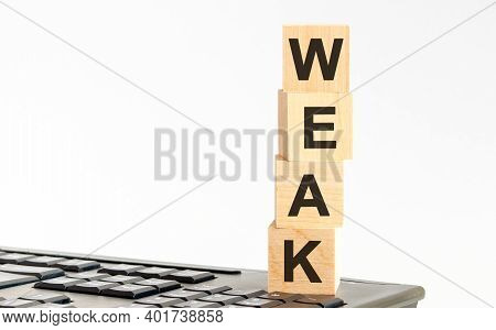 Motivational Words: Weak In 3d Wooden Alphabet Letters On A Keyboard Background With Copy Space, Bus