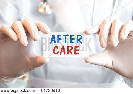 Doctor Holding A Card With Text After Care In Both Hands. Medical Concept