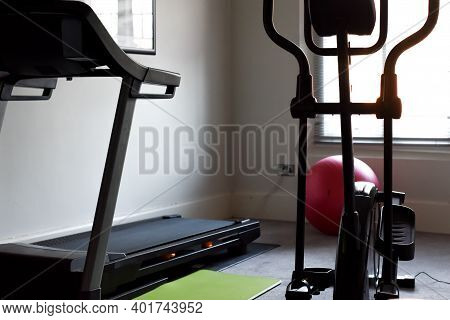 Health And Fitness Gym Equipment In A Home Gym Interior