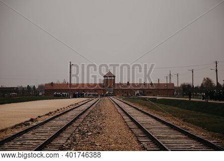 Oswiecim, Poland - April 12, 2019: Auschwitz Birkenau Gate Rail Entrance German Nazi Concentration A