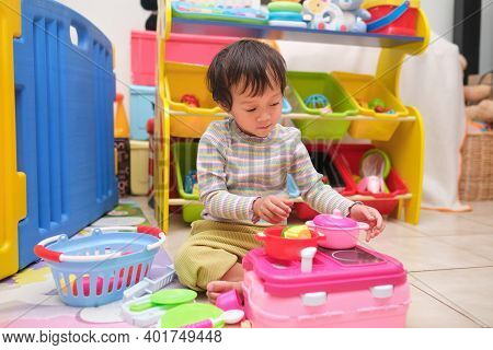 Cute Little Asian 2 - 3 Years Old Toddler Girl Child Having Fun Playing Alone With Cooking Toys, Kit
