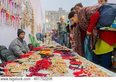 Kolkata, West Bengal, India - 31st December 2018 : Indian Women Choosing Coloutful Handmade Jeweller