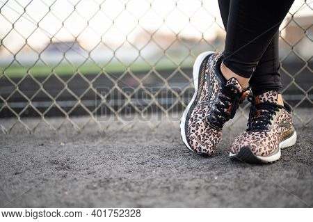 A Woman Runner Wearing Brooks Adrenaline With Leopard Print