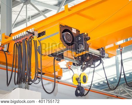 Overhead Crane Or Bridge Crane. Machinery For Manufacturing Or Transportation In Factory Or Warehous