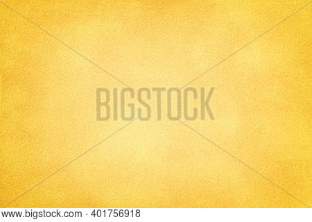Light Yellow Matte Background Of Suede Fabric With Dark Vignette, Closeup. Velvet Texture Of Seamles