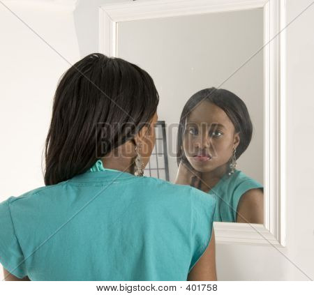 Pretty Girl Looking In A Mirror