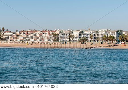 Swakopmund, Namibia - June 18, 2012: A Beach Scene, With Apartment Buildings, In Swakopmund. Palm Tr