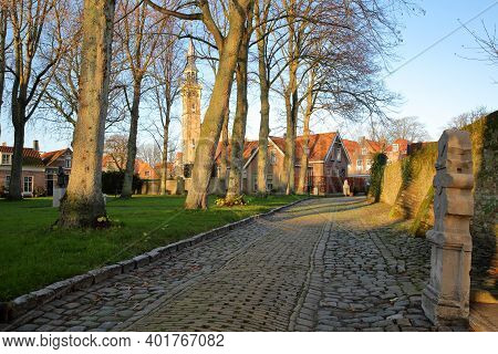A Typical Paved Alley (kerkstaat) With The Stadhuis (town Hall) And Its Impressive Clock Tower In Th