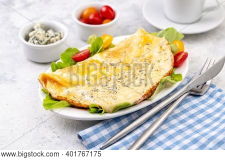 Fried Eggs With Cheese, Cherry Tomatoes And Fresh Lettuce. Omelet With Filling For Breakfast. Health