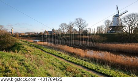 The Colorful Countryside Surrounding Veere, Zeeland, Netherlands, With The Stadhuis (town Hall) In T