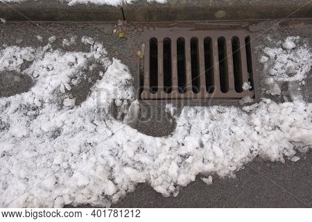 Overhead View Of A Highway Kerbside Drain, Also Known As A Surface Drain, Receiving Water Run Off Fr