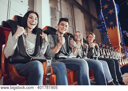 Smiling Friends Are Delighted With Amusement Park.