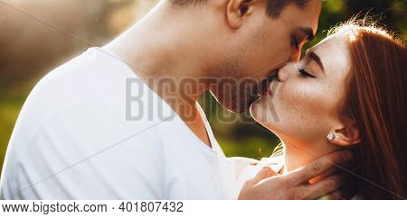 Close Up Photo Of A Caucasian Lady With Freckles And Ginger Hair Kissing Her Lover And Embracing In