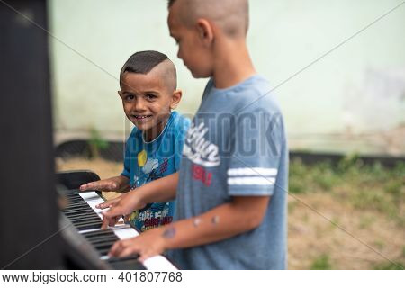 Brno, Czech Republic. 06-11-2016. Children Talking The Piano At A Festival Of Roma People (gypsies)
