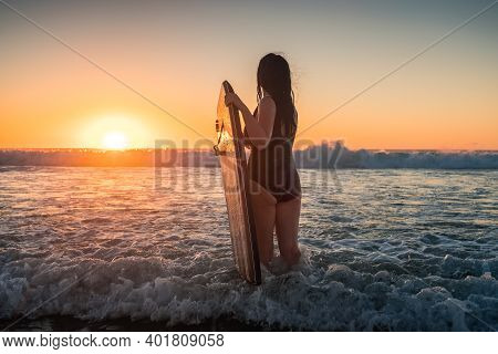 Woman With Bodyboard Ready For A Swim At Sunset, Moana Beach, South Australia
