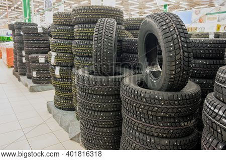 Winter Studded Tires In The Supermarket Of Automobile Tires.