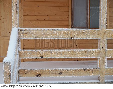 New Wooden House With A Porch Covered With Snow In Winter.