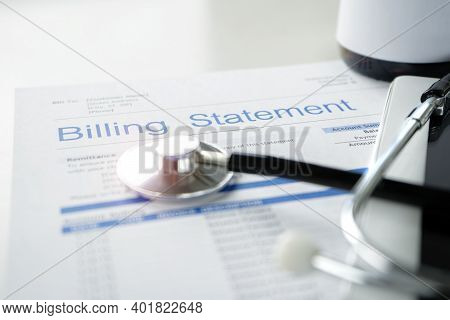 Health Care Billing Statement With Stethoscope, Bottle Of Medicine For Doctor's Work In Medical Cent