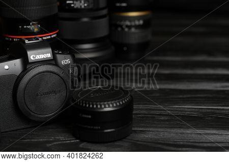 Kharkov, Ukraine - November 23, 2020: Canon Eos R Photocamera With Canon Lenses On Black Table. Cano