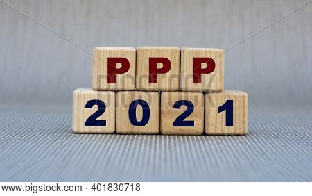 Ppp 2021 - Word On Wooden Cubes On A Gray Background. Business Concept