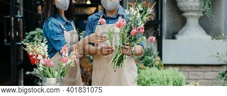 Creation Of Flower Arrangement And Modern Service, Owner Teaches Trainee. Serious Millennial Guy And