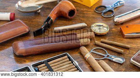 Smoking Tobacco Set And Accessories On Wooden Desk