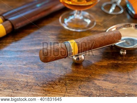 Cuban Cigar And Smoking Accessories On Wooden Office Desk