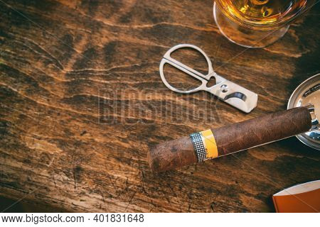 Cuban Cigar And Smoking Accessories On Wooden Desk