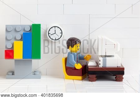 Tambov, Russian Federation - January 03, 2021 Lego Businessperson Minifigure Sitting Behind A Comput